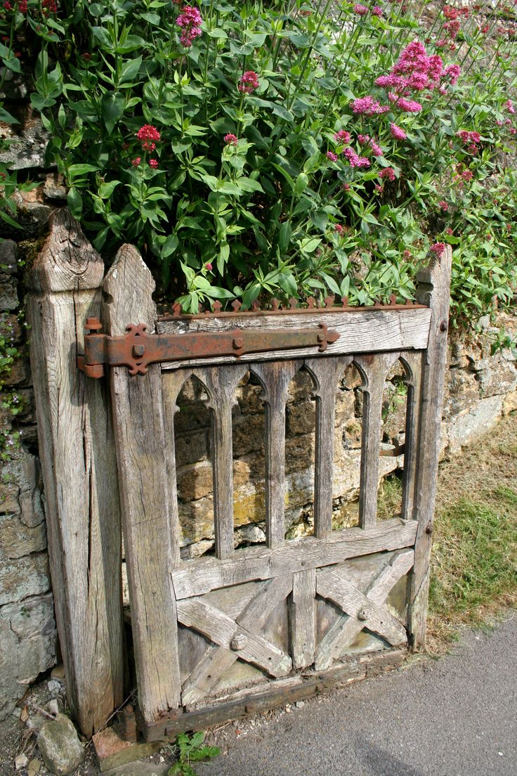 A Lovely Old Rustic/Gothic Gate Makes An Interesting Entrance To A Garden.