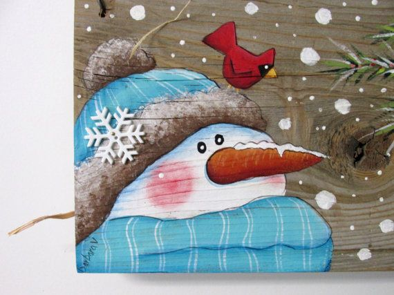 Barn Wood with Painted Snowman and Cardinals, White Snowman, Red Cardinals and Evergreen Tree, Hand or Tole Painted, Reclaimed Barn Wood This whimsical Snowman is welcoming his red winter time guests! This design is based on a Lesa Maloney tole painting pattern. It has been adjusted and adapted to fit on to a piece of old reclaimed barn wood. The barn wood measures 7 1/2 inches tall x 15 1/2 inches wide and is 15 inches tall to include the fencing wire. Fencing wire is used as a ha...