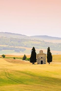 Vitaleta chapel, one of Val d'Orcia's icons, in Tuscany near San Quirico d'Orcia, Italy