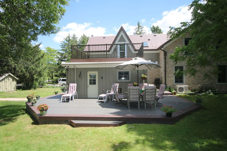 A custom low maintenance deck built by Hickory Dickory Decks on a century home in Flamborough.