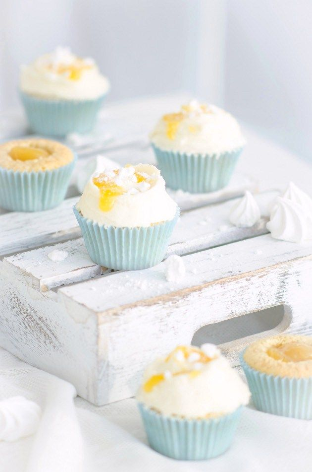 tangy lemon cupcakes with meringue and lemon cream cheese frosting.
