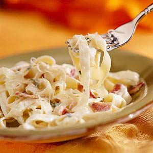 Classic Fettuccine alla Carbonara When prosciutto, Italian for air-dried rather than smoked ham, isn't available, cook two extra slices of bacon instead. This rich and creamy pasta dish is as good or better than the popular restaurant version.