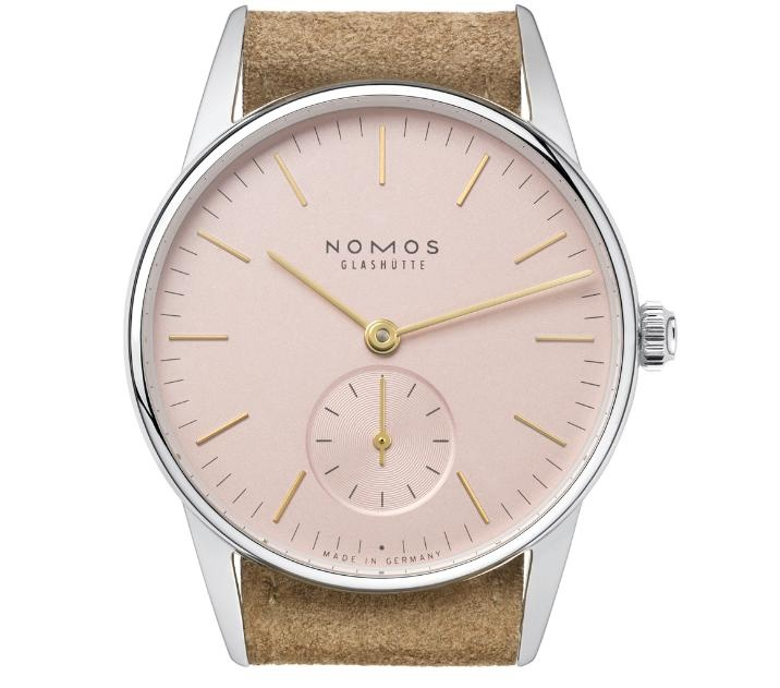 Nice NOMOS watch. Rosey face and gold hands.
