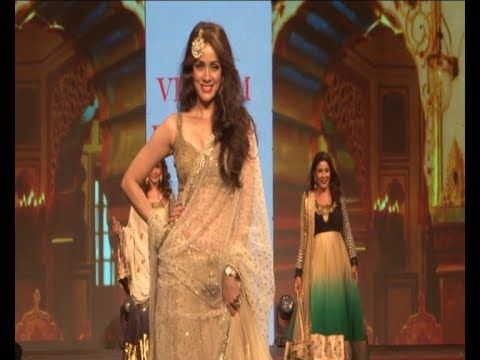 Vidya Malvade walks the ramp in a transparent saree and sleeveless blouse.