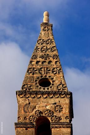 The very top of the bell tower of St Spyridon church, Kardamyli, Mani. Simply an amazing creation of popular art and local craftmanship...