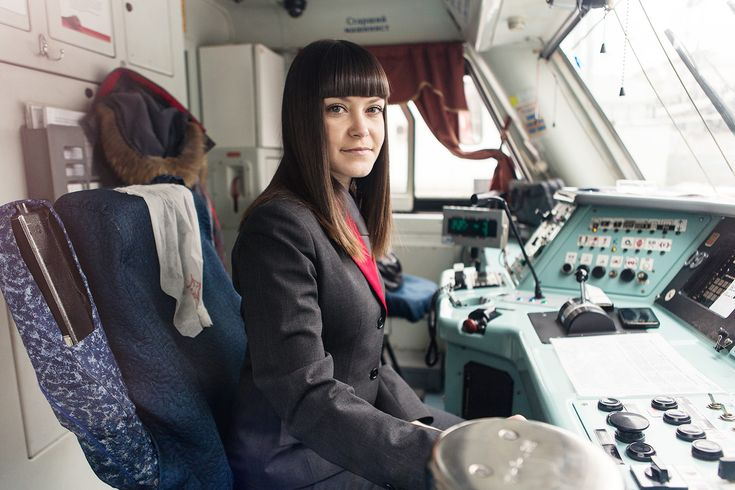 A female train master driving a high-speed train in Moscow