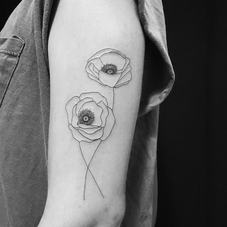Poppy tattoo by Carin Silver.   Poppy tattoos are extraordinary and we have found some of the most exquisite poppy tattoos ever done. Thanks for caring, thanks for sharing.