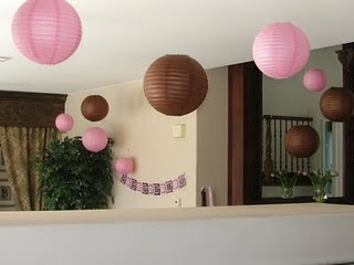 Paper lantern decorations for a pink and brown baby shower.