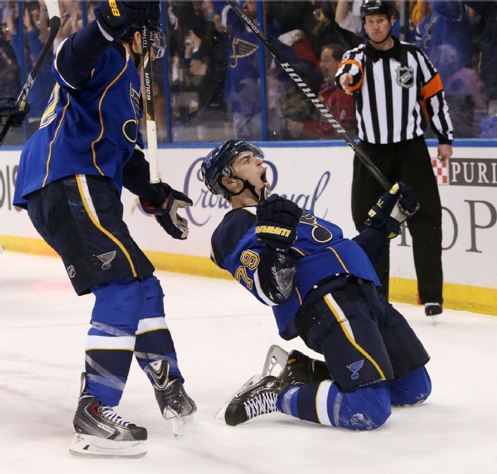 right wing Adam Cracknell reacts after scoring against the Chicago Blackhawks during the first period of Game 1 of an NHL hockey playoff series. Blues won the game 4-3 in triple OT.  4-17-14