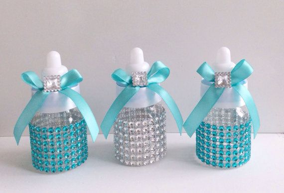 Baby bottles are 3.5 decorated with your baby shower theme. Does not include candies.  Price is for 12 baby bottles for $30   $2.50 each bottle