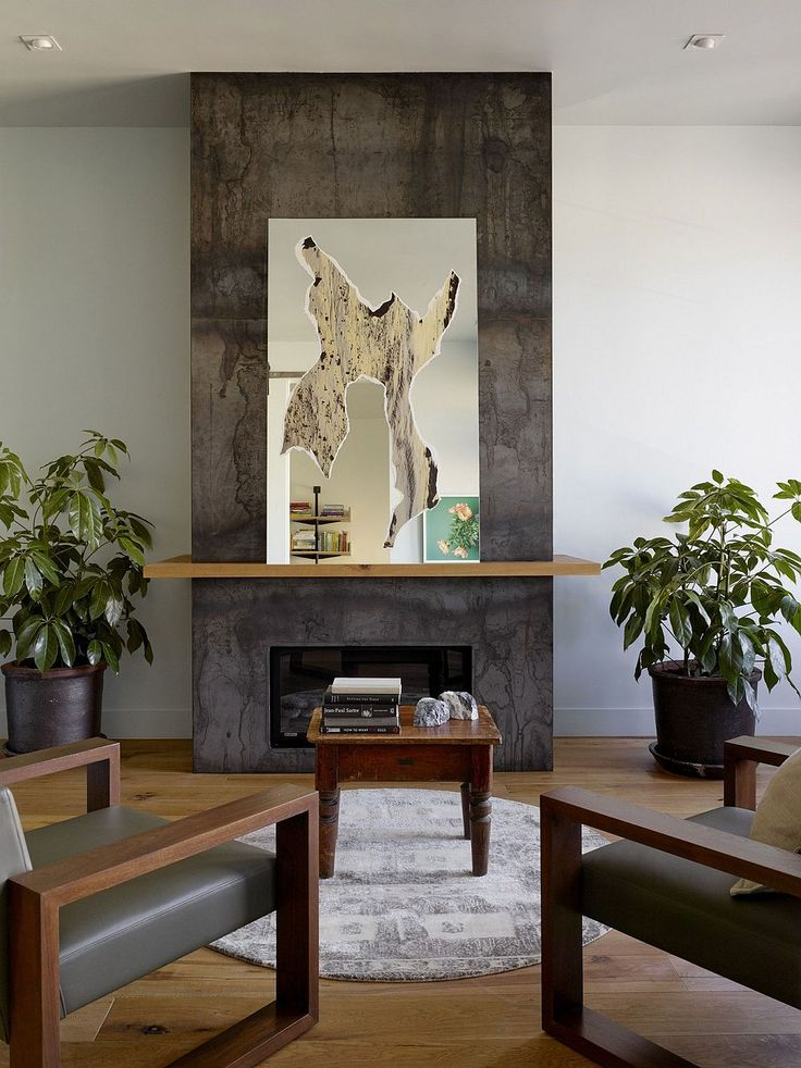Creative decor and mirror transform the space surrounding the fireplace