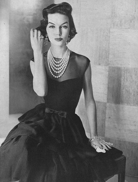 A must have 1950's Little Black Dress...with Pearls, a Bow and a Sweetheart neckline.: