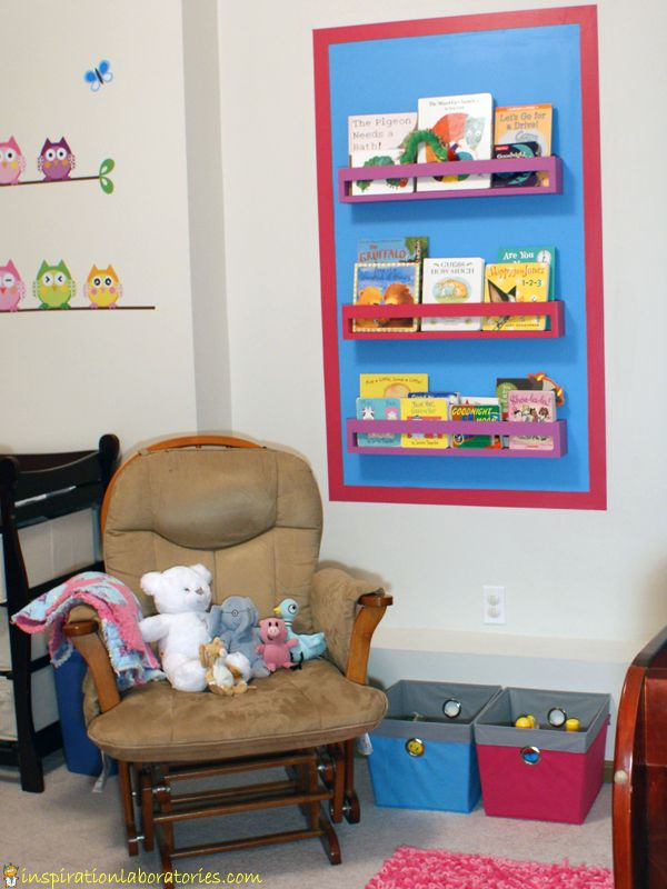 Our Nursery Reading Space: Colorful Bookshelves and Painted Wall Border
