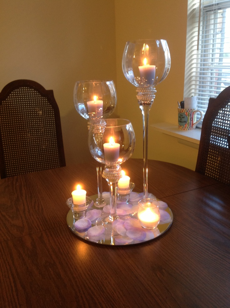 Love this with flowers around the base of the candle holders.