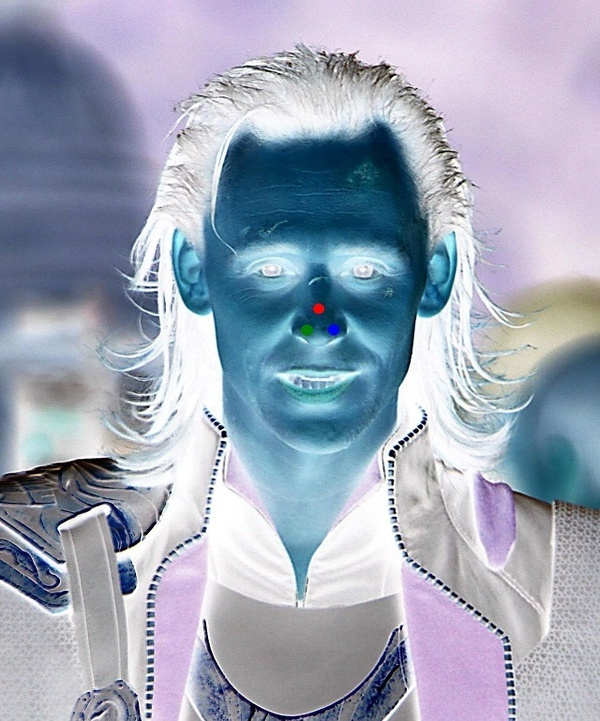1. Stare at the red dot for 30 seconds.  2. Look at a white wall or blank surface and blink.  3. Enjoy.  Tom Hiddleston. Loki.