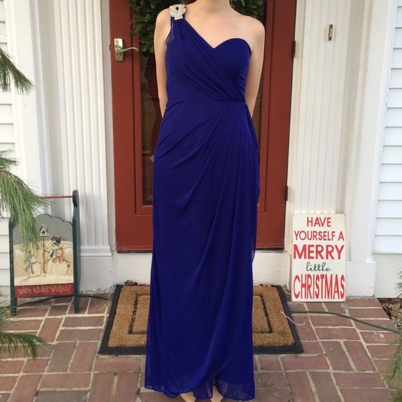 Macy's midnight blue prom dress This beautiful asymmetrical midnight blue Macy's prom dress has a silver sparkly embellishment. It has flowing and layered material. It it gathered in the back. It is classy and elegant, you will look like a goddess. It has a padded bodice. Macy's Dresses Maxi