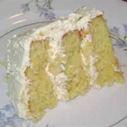 Pig Pickin' Cake - Start with a yellow cake mix, 4 eggs, 1/2 c. oil, and 15 oz can mandarin oranges with juice.  Bake at 350 in 3 round pans.  Let cool and frost layers and cover top and sides with small box of vanilla pudding, crushed pineapple with juices and whipped topping mixed together into a light, fluffy frosting.  So good and not overly sweet!