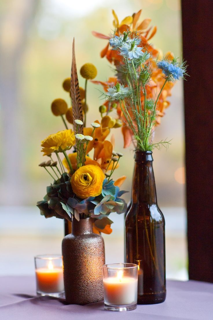 Rustic Wedding Flowers With Pheasant Feathers And Beer