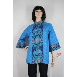 Blus batik dari bahan katun motif timbul/embos, dipadukan dengan kain tenun motif unik.