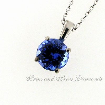 Centre stone is a 1.95ct round cut tanzanite set in a classic 4 claw 18k white gold setting
