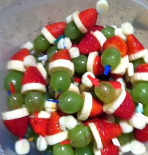 Grinch Party Poppers - Would use green grapes, slice of cheese stick, strawberry, small dot of whipped cream or toothpick with white top