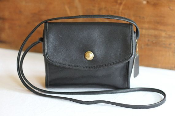 A vintage Chrystie mini crossbody messenger bag in black leather. This one has a…