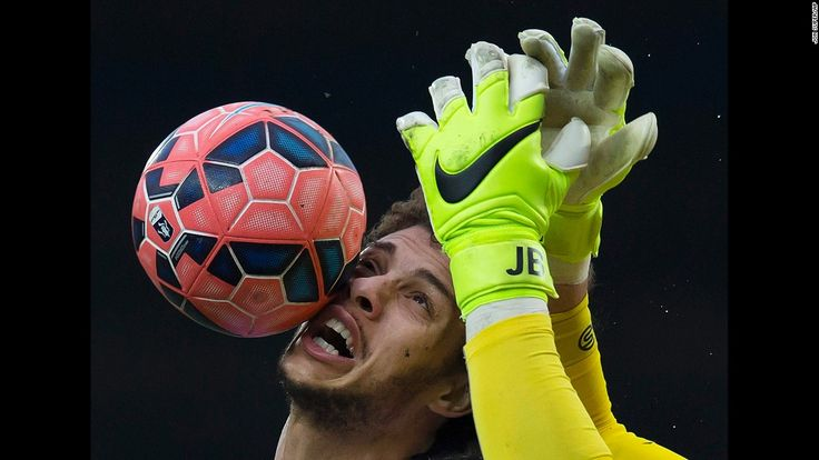 Blackburn's Rudy Gestede is sandwiched between the ball and the hands of Stoke City goalkeeper Jack Butland during a fifth-round FA Cup match Saturday, February 14, in Blackburn, England. Gestede scored a goal in the match as Blackburn won 4-1.