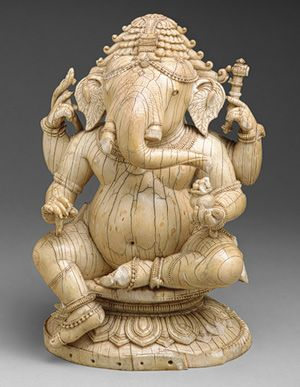 Fourteenth-to-fifteenth-century ivory Indian seated Ganesh(a). (Metropolitan Museum of Art)