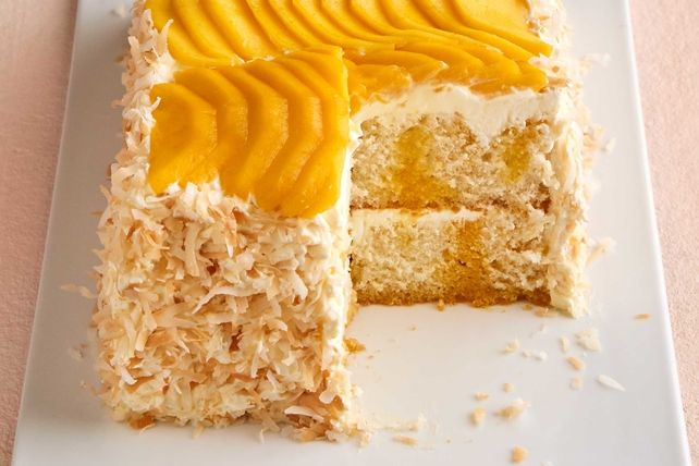 Satisfy your sweet tooth with our Mango Coconut Poke Cake. Our Mango Coconut Poke Cake is the perfect dessert to serve during the summertime.