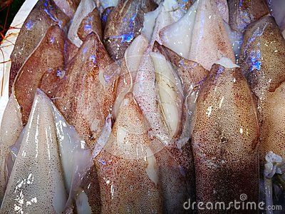 Fish market Raw wet fish glistening in a basket in the market, some with brown skin and others white. . Photo taken on: November 12th, 2016