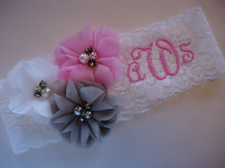 Monogramed wedding garter  with decorations of chiffon flowers.  Stretch lace Style 0.  TheWeddingGarter.com