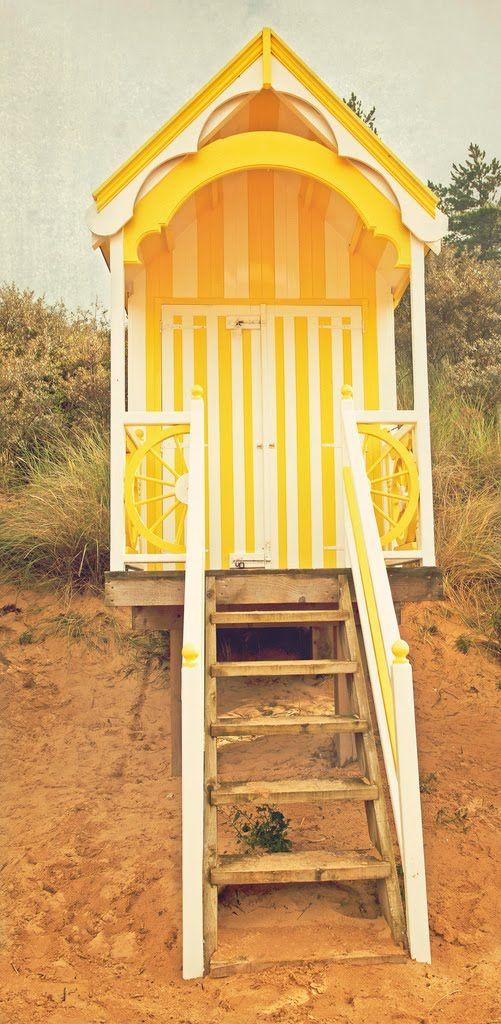 pretty little canary yellow beach hut.