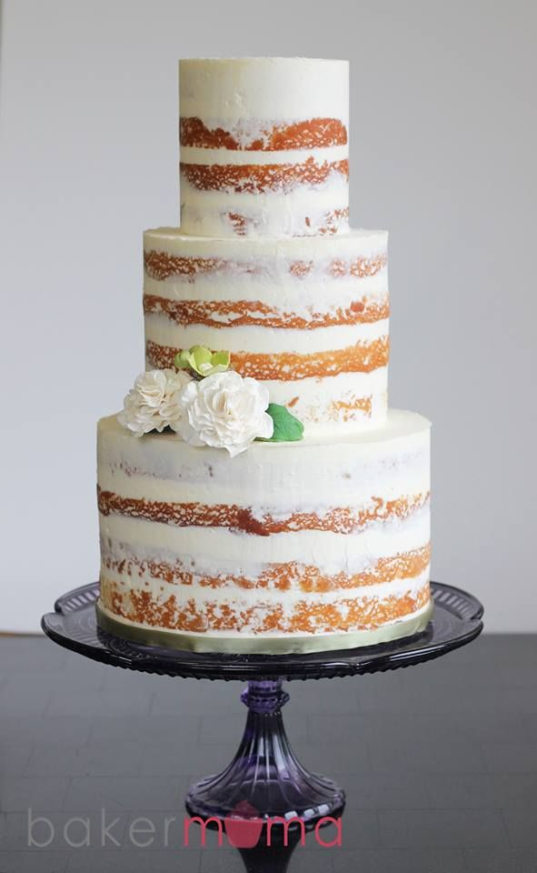 Naked cakes don't have to be completely naked.  A little bit of frosting goes a long way on this cake.  Love the look of this naked cake!  Simple, elegant.
