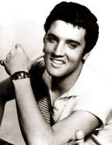Elvis Presley shows his pearly whites.