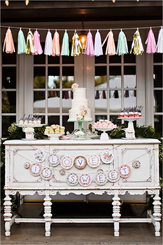 Shabby chic dessert table with tassel garlands