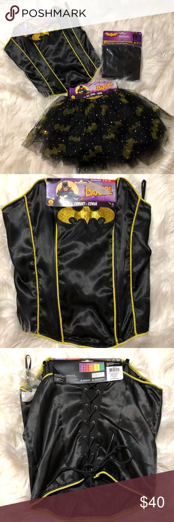 Batgirl costume Batgirl costume. Perfect for Halloween, cosplay or comic con. Includes batgirl corset. Laces down the back and comes with clear bra straps if you would like to use them or can be worn without. Also includes batgirl tutu with the bat sign and glitter through out and brand new boot tops. Complete batgirl costume! Everything is brand new! Size small Other