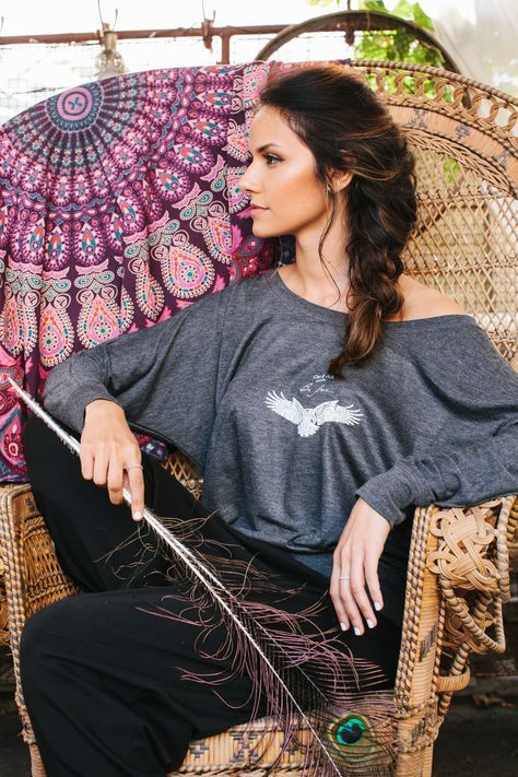 """Why fit in when you were born to stand out? Channel your wild heart and free spirit in our ethically-sourced """"Eagle"""" long-sleeved tee. It comes in both white and grey, and the slouchy relaxed style make it a perfect top for brunch or the gym. Be free and spread your wings; shop this and other inspirational tees now on our site. #bohochic"""