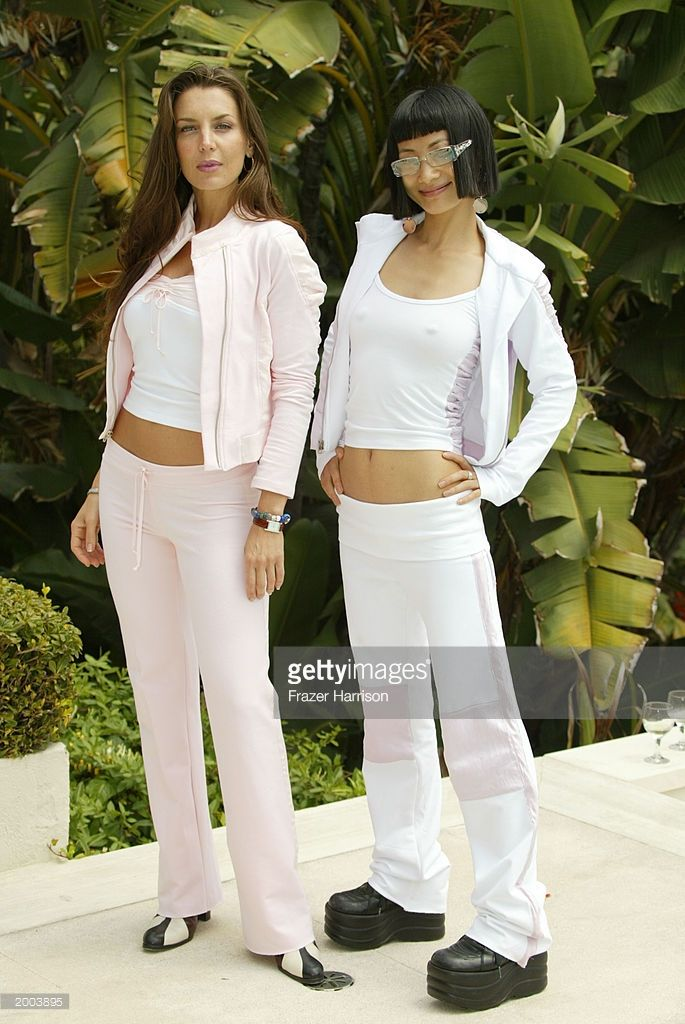 Actress Bai Ling, (R) and Actress Sandra Vidal (L) model clothes from H. Starlet designer Heidi Cornell at the H. Starlet Day of Beauty Breakdown on May 15, 2003 in Beverly Hills, California.