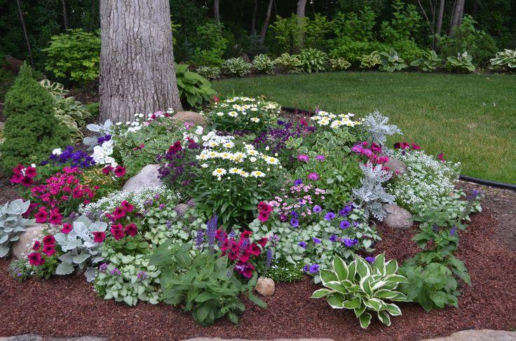 rock garden with hostas and flowers