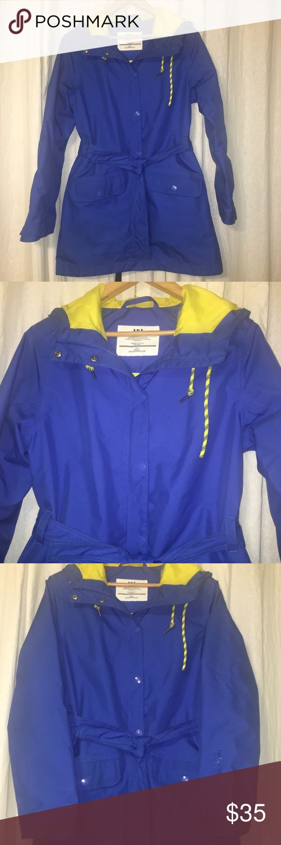 Helly Hansen Raincoat with Flaws - Sz Small 🌟🌟Please Read🌟🌟 This jacket is in pre-owned condition with signs of wear. There are dirt/stains throughout the coat. Most of the wear is on the pockets, sleeves and bottom of the jacket. The dirt/stains will need a good cleaning or may be worn as-is for running around town.  Please message with any questions. This jacket is being sold as-is and at a low because of the dirt/stains. @Broken hood cord@. This jacket is not for everyone but still…