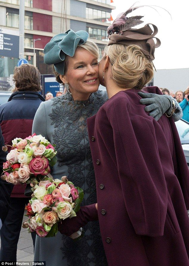 Proving just a popular as one another both Queens were gifted with a bouquet of flowers from their adoring public