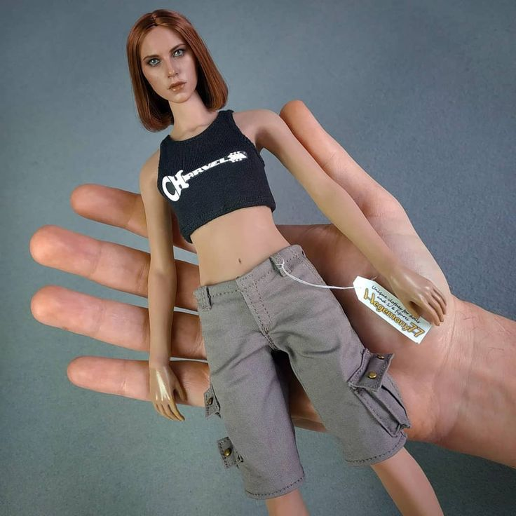 1/6th scale female Phicen figure doll in heather grey tank