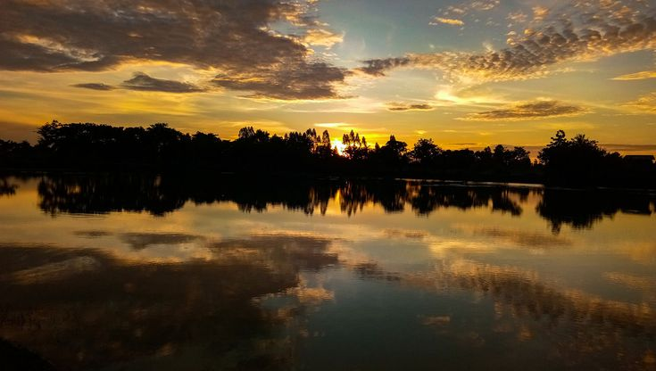 reflection, sunset, water, tranquil scene, scenics, tranquility, beauty in nature, nature, sky, tree, lake, no people, silhouette, outdoors, cloud - sky, day