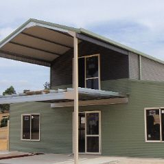 American barn with 2 tone cladding and gable end balcony extension.