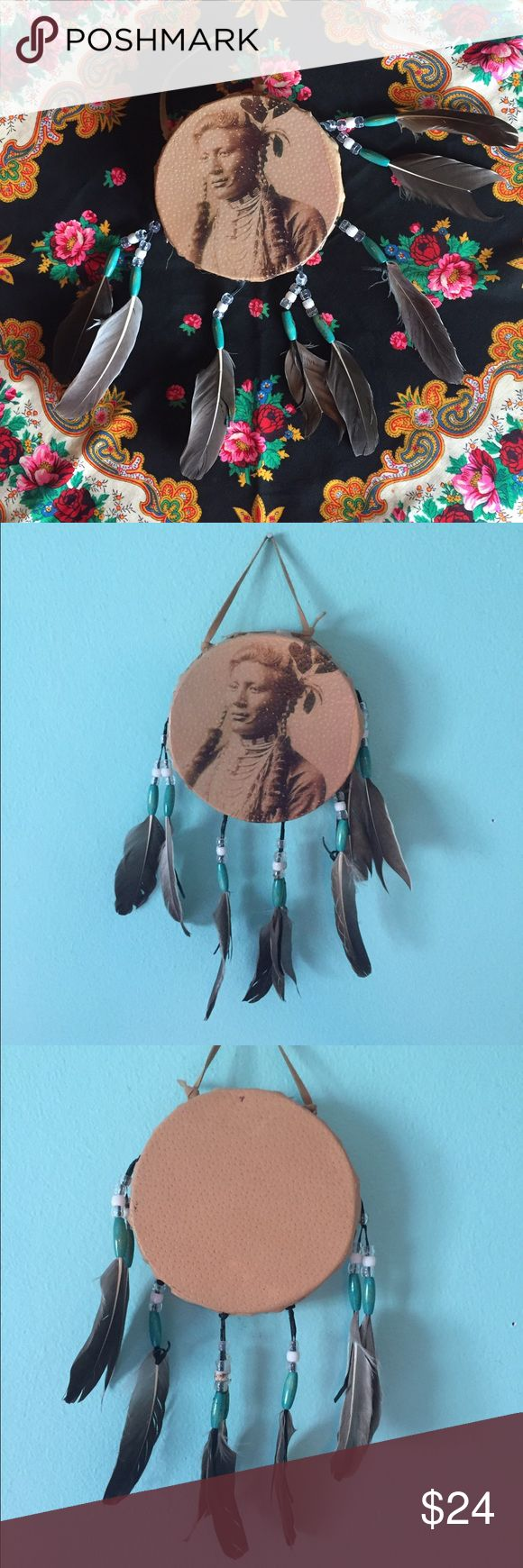 Native American decorative drum southwestern BoHo Really rustic looking vintage style Native American picture on faux leather. Drum is decorative and looks to be made of a light wood. Wooden turquoise colored beads and plastic pony beads with feathers. Entire thing measures approximately 13 inches long including feathers. Perfect to give your room that BoHo vibe! Vintage Accessories