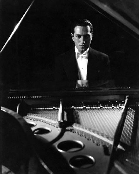 "George Gershwin. At 25, his jazz- influenced ""Rhapsody in Blue"" premiered in New York. His best known works include ""An American in Paris"", ""Cuban Overture"" and ""Lullaby for Strings"", as well as ""Porgy and Bess"", which included ""Summertime"". Unfortunately, at the young age of 38, he died of a brain tumor. Who knows what other beautiful music he would have created…."