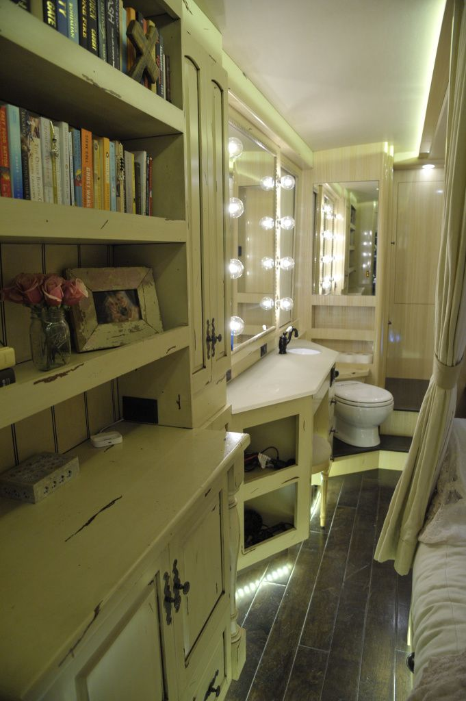 Kellie Pickler's Tour Bus, A bookcase where Kellie Pickler keeps her favorite books to read in her tour bus, as featured in HGTV's Celebrity Motor Homes. © 2011, HGTV/Scripps Networks, LLC. All Rights Reserved. Kellie's Official GACTV.com Photo Gallery For more on HGTV's Celebrity Motor Homes,