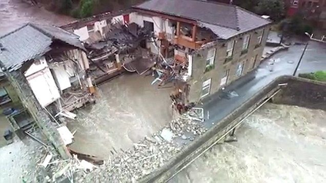 Dramatic drone footage shows pub washed away by floods in Summerseat on the River Irwell.