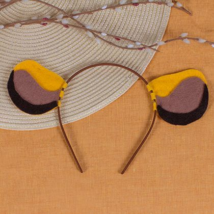 Incredibly cute Simba ears....this site has a lot of cute headband ear crafts.