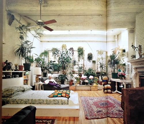 I know this is a bedroom, but I like the sun drenched, plant filled idea for the living room. I like my bedroom dark.